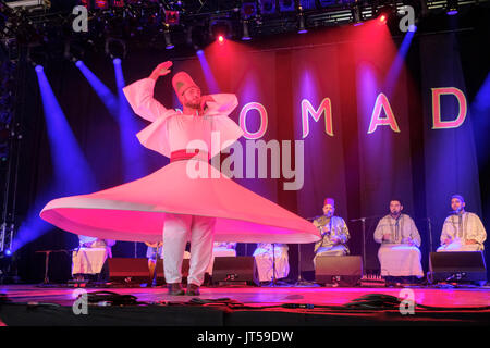 Noureddine Kourchid and the Whirling Dervishes of Damascus performing at the WOMAD Festival, Charlton Park, Malmesbury, - Stock Photo