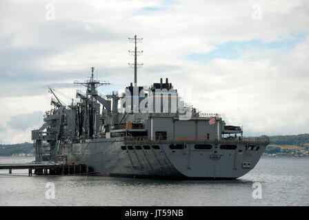 U.S. Naval Ship Supply T-AOE-6 Berthed at Loch Striven Scotland rear port side landscape view of battleship grey - Stock Photo
