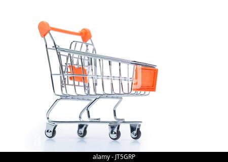little metallic empty shopping cart isolated on white - Stock Photo
