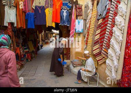 Street life scene. Souk Medina of Fez, Fes el Bali. Morocco, Maghreb North Africa - Stock Photo