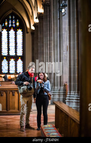 NEW YORK, USA - October 14, 2016. Two Photographers Visiting Inside of Trinity Church Located on Wall Street and - Stock Photo
