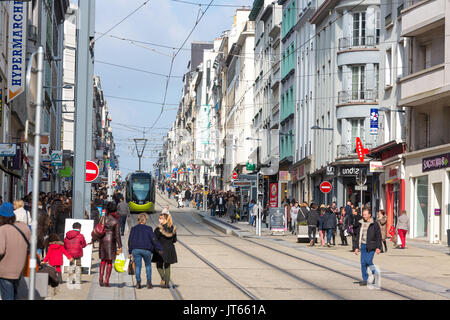 Brest (Brittany, north-western France): tram and pedestrians in the street 'rue Jean Jaures', in downtown Brest. - Stock Photo