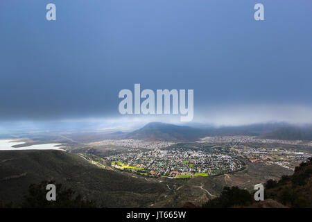 Valley of Desolation viewpoint, view of the city of Graaff Reinet during a storm, South Africa - Stock Photo