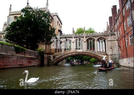 Tourists enjoying a punt along the River Cam passing under the historic  Bridge of Sighs built in1831 at St John's - Stock Photo