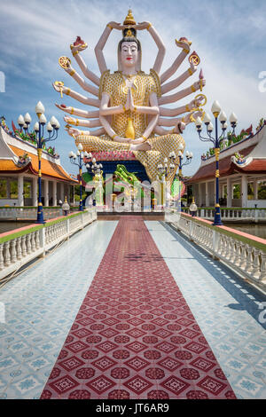 Statue of eighteen arms of Guanyin Avalokiteśvara or Guanjin Kwan Yin, Goddess of Mercy and Compassion, Wat Plai - Stock Photo