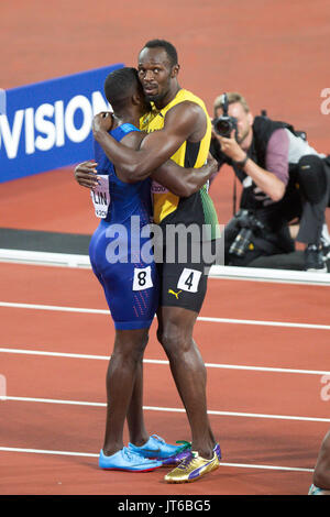 LONDON, ENGLAND - AUGUST 05: Usain Bolt  and Justin Gatlin (blue top) after the Men's 100m final during day two - Stock Photo