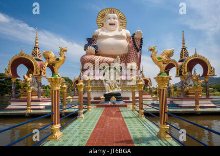 Giant statue of Big Happy Buddha, Wat Plai Laem Temple, Suwannaram Ban Bo Phut, Koh Samui, Thailand - Stock Photo