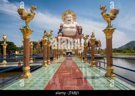 Giant statue of Big Happy Buddha, Wat Plai Laem Temple, Suwannaram Ban Bo Phut, Koh Samui, Thailand - Stock Photo