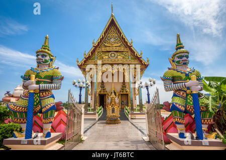 Giant guardians at entrance of the Buddhist Pagoda, Wat Plai Laem Temple, Suwannaram Ban Bo Phut, Koh Samui, Thailand - Stock Photo