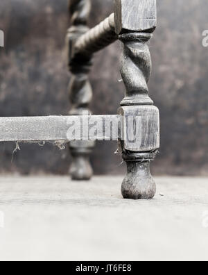 Traditional jacobean style old dusty weathered oak antique chair barley twist legs - Stock Photo