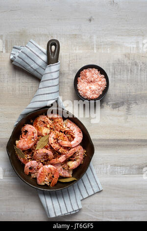 Cooked red shrimp on a light background. Prepared in a frying pan - Stock Photo