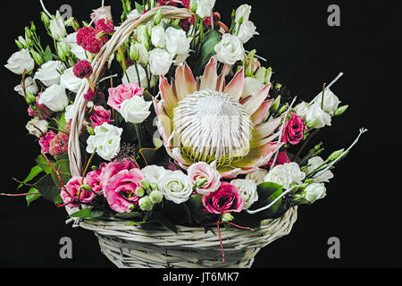 Basket of flowers on dark - Stock Photo