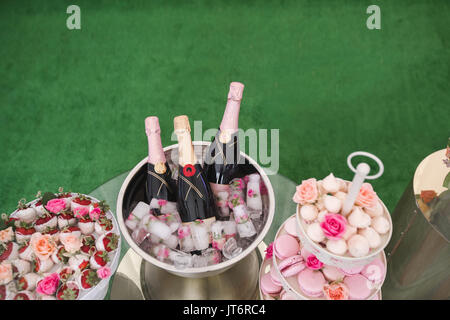Sweet table with dessert and champagne - Stock Photo