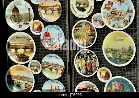 Circular shaped souvenirs glass plates- dishes on sale to tourists in Florence( Firenze) Italy, Europe - Stock Photo