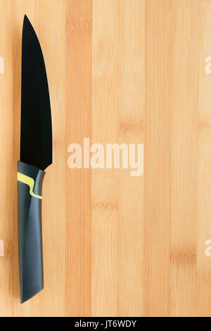 chef of modern restaurant with sharp kitchen knife going to halve