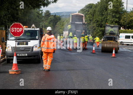 New junction and tarmac resurfacing at Highfield Road works, Lydney Gloucestershire. UK to accommodate a new housing - Stock Photo