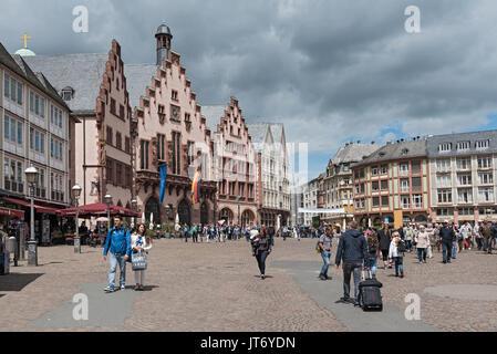 People on Roemerberg square in Frankfurt, Germany - Stock Photo