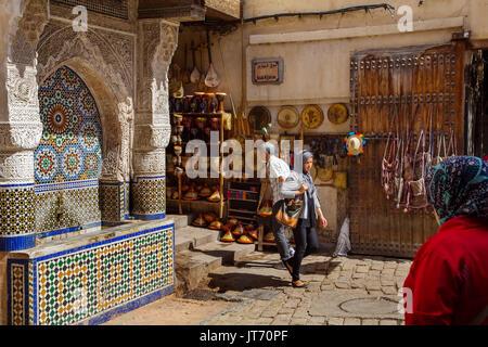 Nejjarine Fountain, Ceramic craft shop. Souk Medina of Fez, Fes el Bali. Morocco, Maghreb North Africa - Stock Photo