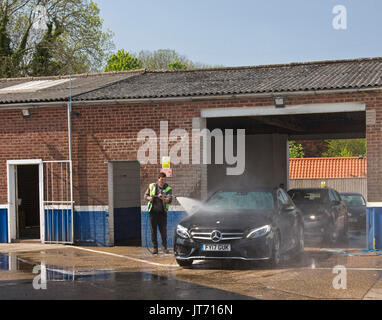 Person using water hose in garden close up stock photo for Mercedes benz car wash free