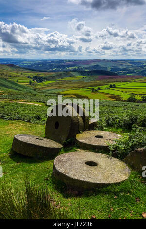 Abandoned millstones, below Stanage Edge, Peak District, Derbyshire - Stock Photo