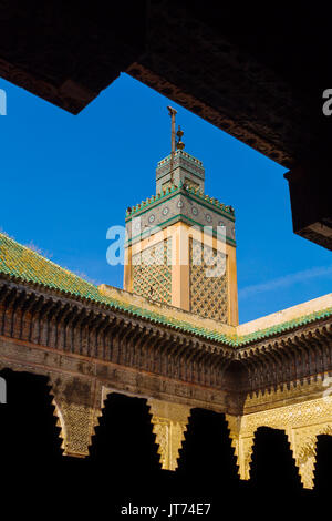 The Madrasa Bou Inania or Medersa Bu Inaniya.Souk Medina of Fez, Fes el Bali. Morocco, Maghreb North Africa - Stock Photo