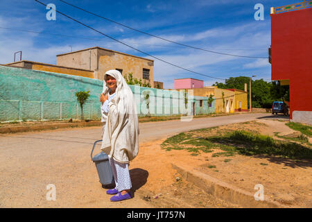 Bhalil, woman in white dress covering her head. Morocco, Maghreb North Africa - Stock Photo
