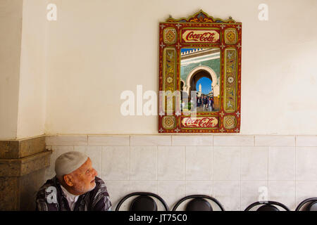 Street life scene. Bab Bou Jeloud gate reflected in a mirror, main entrance to Souk Medina of Fez, Fes el Bali. - Stock Photo