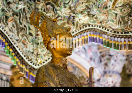 statue in the tomb of emperor Khai Dinh in Hue, Vietnam - Stock Photo