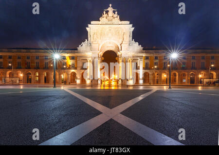 Commerce Square at night in Lisbon, Portugal - Stock Photo