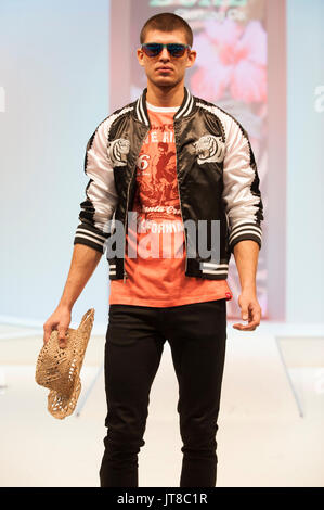Male model wearing clothes by Duke London on the catwalk at Moda. Moda, Britain's largest trade exhibition for fashion - Stock Photo