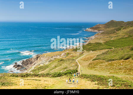 17 June 2017: Woolacombe, Devon, England, UK - A group of people on the South West Coast Path heading towards Morte - Stock Photo