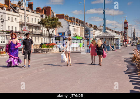 2 July 2017: Weymouth, Dorset, England, UK - Some of the sights of Weymouth Promenade, including a pantomime dame, - Stock Photo
