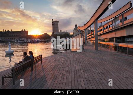 Rambla del Mar at Port Vell, Edificio Colon Tower and Columbus Monument (Monument a Colom), Barcelona, Catalonia, - Stock Photo