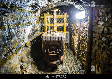 Mine shaft behind the Great Laxey Wheel, Isle of Man, crown dependency of the United Kingdom, Europe - Stock Photo