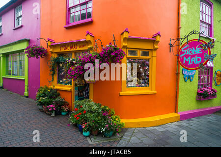 Brightly coloured shops in Kinsale, County Cork, Munster, Republic of Ireland, Europe - Stock Photo