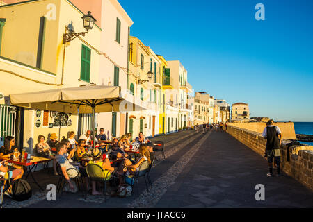 Restaurant on the ocean promenade in the coastal town of Alghero, Sardinia, Mediterranean, Italy, Europe - Stock Photo