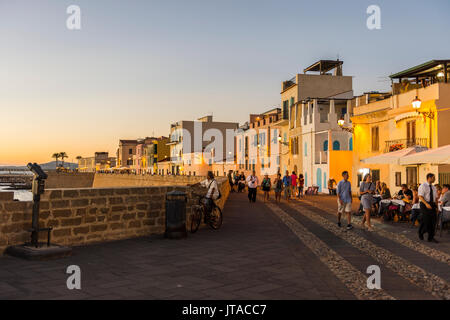 Ocean promenade in the coastal town of Alghero after sunset, Sardinia, Italy, Mediterranean, Europe - Stock Photo