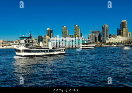 Little tourist cruise ship with the skyline in the background, Harbour of San Diego, California, USA, North America - Stock Photo