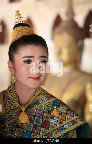Bride wearing traditional Lao costume for her wedding, Wat Si Sake, Vientiane, Laos, Indochina, Southeast Asia, - Stock Photo