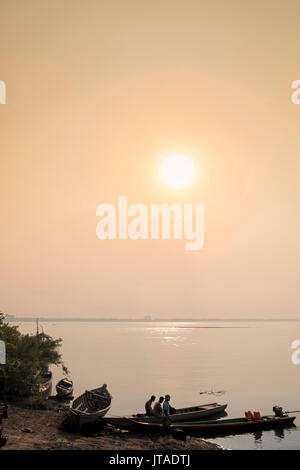 Fishing boats at dawn on the Mekong River near Kratie in Cambodia, Indochina, Southeast Asia, Asia - Stock Photo