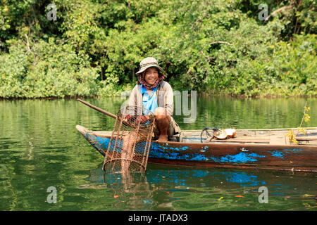 Crayfish fisherman on a tributary of the Phipot River in the Cardamom mountains, Koh Kong, Cambodia, Indochina, - Stock Photo