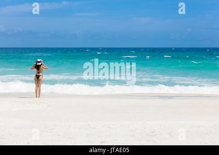 A young Brazilian woman in a bikini on Arraial do Cabo Beach, Rio de Janeiro State, Brazil - Stock Photo