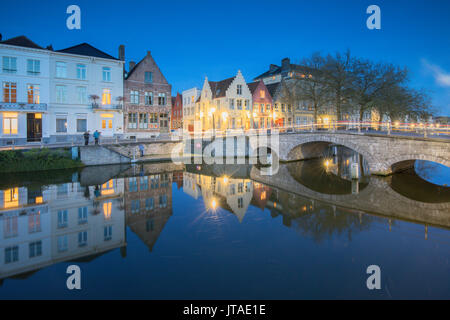 Dusk lights on the historic buildings of the city centre reflected in typical canals, Bruges, West Flanders, Belgium, - Stock Photo