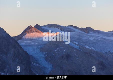 View of the Pisgana glacier and rocky peaks at dawn, Valcamonica, border Lombardy and Trentino-Alto Adige, Italy, - Stock Photo
