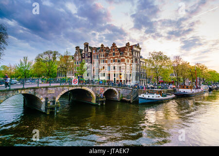 Traditional Dutch gabled houses and canal, Amsterdam, Netherlands, Europe - Stock Photo