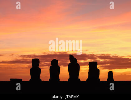 Moais in Ahu Vai Uri at sunset, Tahai Archaeological Complex, Rapa Nui National Park, UNESCO, Easter Island, Chile - Stock Photo