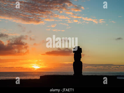 Moai in Ahu Ko Te Riku at sunset, Tahai Archaeological Complex, Rapa Nui National Park, UNESCO, Easter Island, Chile - Stock Photo