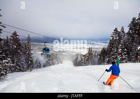 Piste skiers, Bansko resort, Bulgaria, Europe - Stock Photo