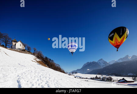 International hot air balloon festival, Chateau-d'Oex, Vaud, Swiss Alps, Switzerland, Europe - Stock Photo