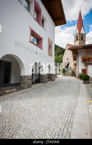 Village of St. Pankraz in D'ultimo/South Tyrol on Via DÖRFL next to the town hall view towards the Chapel St. Helena - Stock Photo
